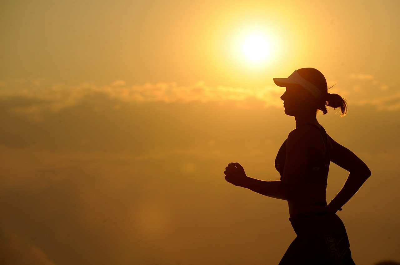 running woman during sunset