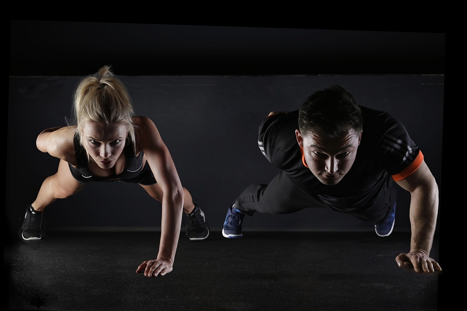 man and woman doing sport